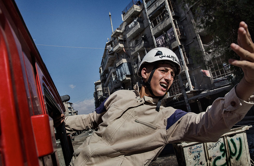 Young man in helmet, Syria Civil Defense member