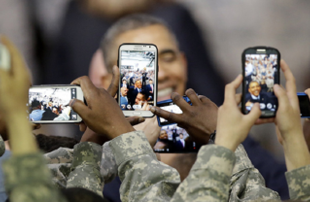 military person using smart phone