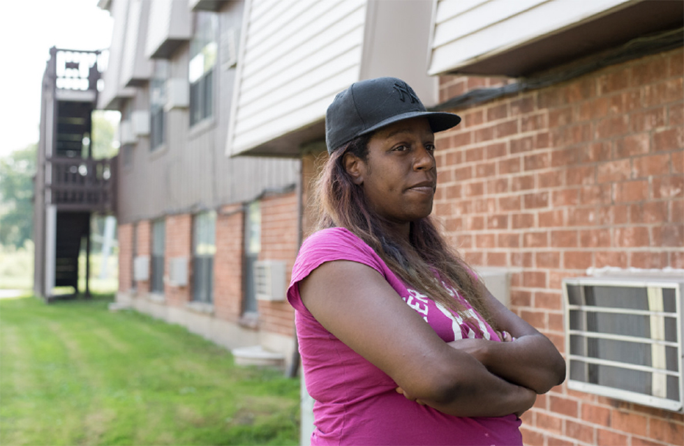 Sheena Godfrey stands outside her home at the Concordia Place Apartments in Riverdale