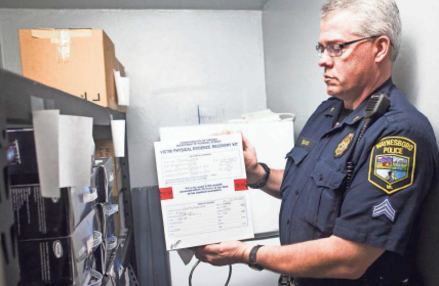 police officer with rape kit form