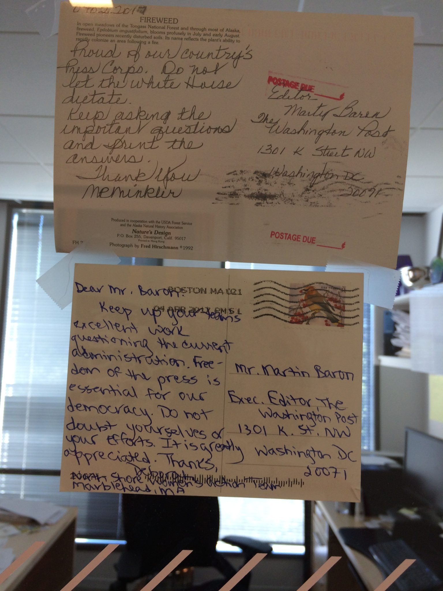 letters from grateful readers addressed to the washington post executive editor marty baron hang on his office walls